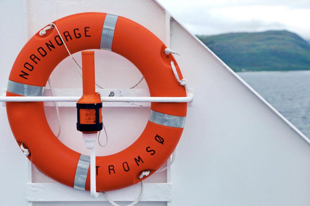 orange and white ship wheel
